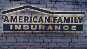 American Family Insurance Sign on Blue-Gray Brick Wall