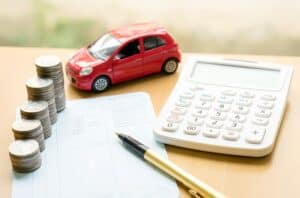 Toy Car, Calculator, Piles of Coins