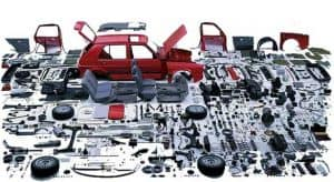 Disassembled Car Surrounded by Parts