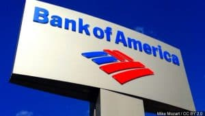 Sign Against Blue Sky with Bank of America Name and Logo