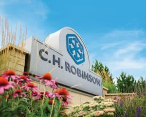 CH Robinson Sign Amid Flowers and Greenery
