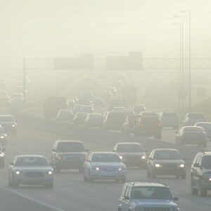 Cars on Highway in Haze of Emissions