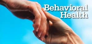 "One Person's Hand Lifting Another's with Words ""Behavioral Health"""