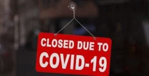 "Sign in Window Saying, ""Closed Due to Covid-19"""
