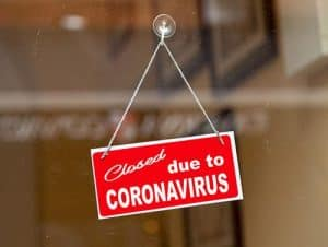 "Sign in Store Window Saying, ""Closed Due to Coronavirus"""