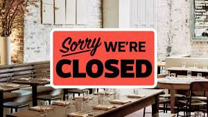 "Sign ""Sorry We're Closed"" on Restaurant Window"