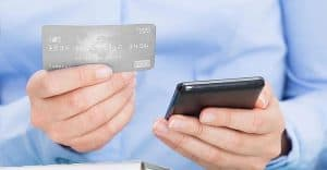 Man's Hands Holding Credit Card and Smartphone