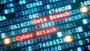 "Lit Rows of Numbers with Words ""Data Breach"" and Cyber Attack"""