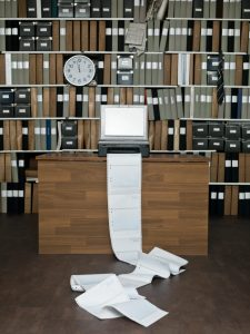 Long Stream of Junk Faxes Emerging from Machine