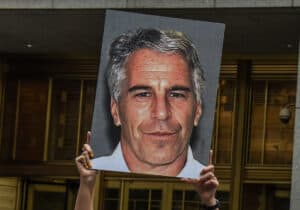 Jeffrey Epstein Portrait Held Up by Protester