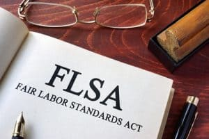 """Open Book on Desk with Title Page """"FLSA"""""""