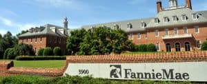 Brick Building with Lawn and Fannie Mae Sign in Front