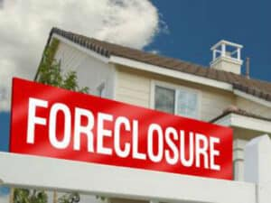Foreclosure Sign in Front of Home