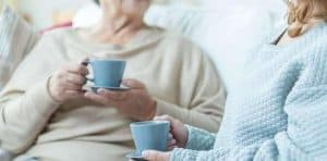 Old Woman and Younger Woman Having Tea Together