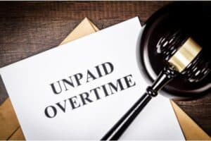 Judge's Gavel and Paper Saying Unpaid Overtime