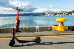 Jump Scooter on Road by Water