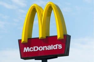 McDonald's Golden Arches Sign Against Blue Sky