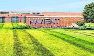 Navient Sign on Green Lawn in Front of Building
