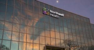 A Glass-Fronted Northwell Health Building Reflecting the Sky