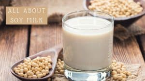 Glass of Soymilk with Containers of Soybeans