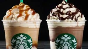 Two Frappucinos, Piled High with Whipped Cream and Toppings