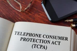"Open Book with Page Reading ""Telephone Consumer Protection Act"""