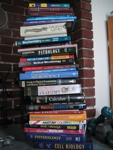 Pile of College Textbooks, About to Topple