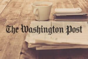 The Washington Post on Table with Coffee Cup