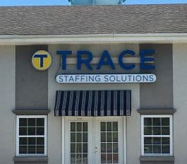 Building with Trace Staffing Solutions Sign