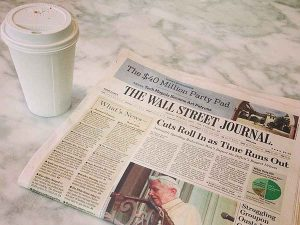 Wall Street Journal Beside Coffee Cup