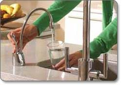 Woman Filling Glass of Water from Tap