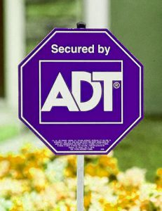 ADT Sign Among Flowers