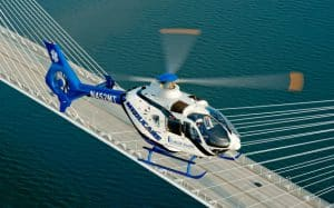 AirMedCare Helicopter Flying Over Bridge
