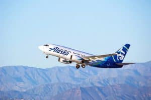 Alaska Airlines Plane, Gaining Altitude, with Mountains in the Background