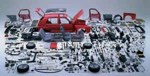 Disassembled Car with Parts Laid Out Around It