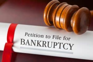 Gavel and Bankruptcy Petition Bound with Ribbon