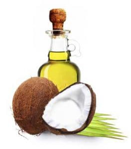 Opened Coconut with Bottle of Oil behind It