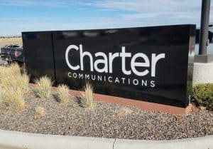 Charter Communications Sign in Dry Landscape