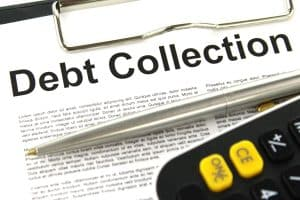 """Papers on Clipboard Saying """"Debt Collection"""""""