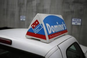 Roof of Car with Domino's Sign