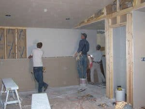 Workers Installing Drywall