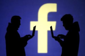 """Facebook """"f"""" Logo with Silhouettes"""
