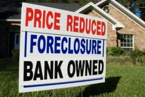 "Sign Saying, ""Price Reduced. Foreclosure. Bank Owned."""