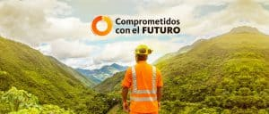 Worker in Safety Gear Gazing at Mountains