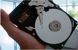 Hard Disk Drive with Triangular Suspension Assembly at Center of Image