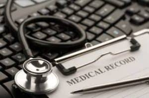 Keyboard, Stethoscope, and Medical Records