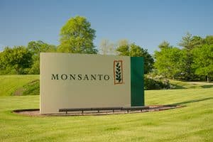 Monsanto Sign on Green Lawn