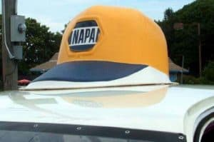 Trademark Napa Auto Parts Cap on Top of Delivery Truck