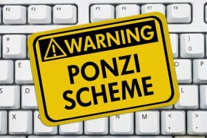 "Keyboard with Sign, ""Warning. Ponzi Scheme."""