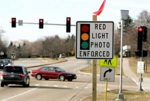 "Crossing with Sign: ""Red Light Photo Enforced"""